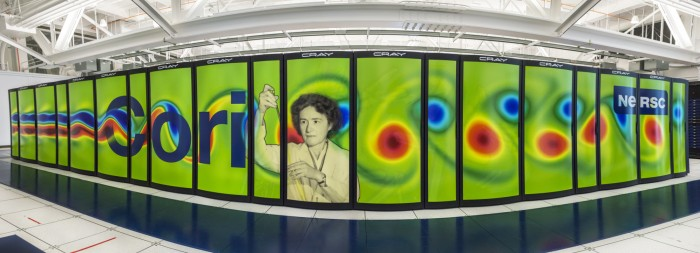 Photo of Cori supercomputer showing mural featuring the scientist's photo.